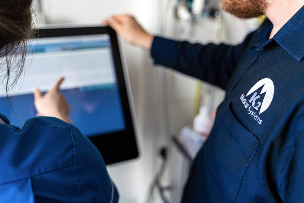 Abstract image of a nurse receiving training in the use of K2 Portal